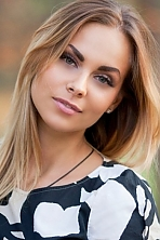 Ukrainian girl Sasha,32 years old with blue eyes and blonde hair.