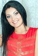 Ukrainian girl Kristina,31 years old with grey eyes and black hair.