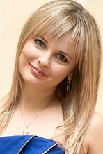 Ukrainian girl Irina,32 years old with grey eyes and blonde hair.
