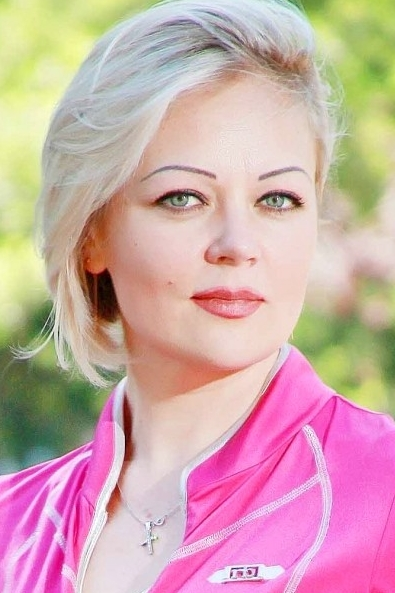 Ukrainian girl Svetlana,39 years old with grey eyes and blonde hair.