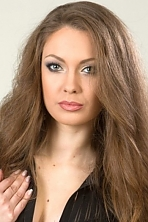 Ukrainian girl Tatiana,22 years old with green eyes and light brown hair.