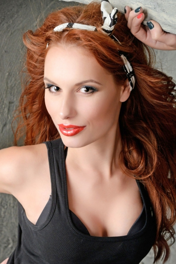 Ukrainian girl Karina,28 years old with green eyes and red hair.