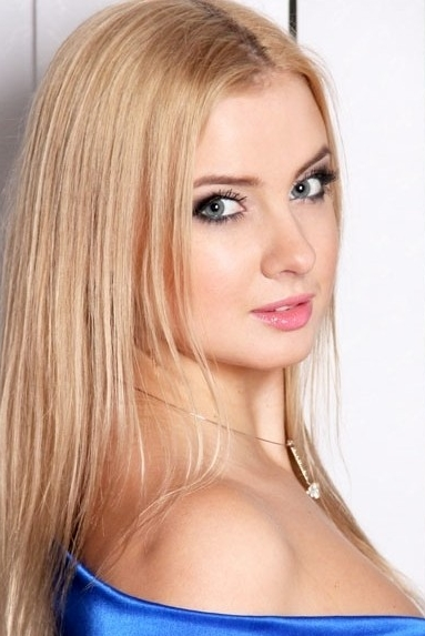 Ukrainian girl Julia,28 years old with blue eyes and blonde hair.