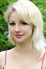 Ukrainian girl Elina,23 years old with hazel eyes and blonde hair.