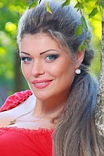 Ukrainian girl Elvira,25 years old with blue eyes and light brown hair.