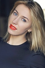 Ukrainian girl Ekaterina,21 years old with grey eyes and blonde hair.