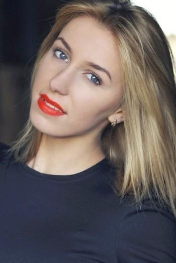 Ukrainian girl Ekaterina,21 years old with grey eyes and blonde hair.