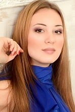 Ukrainian girl Galina,22 years old with brown eyes and light brown hair.
