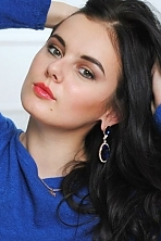 Ukrainian girl Dasha,21 years old with brown eyes and black hair.