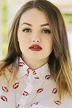 Ukrainian girl Anastasia,20 years old with green eyes and light brown hair.