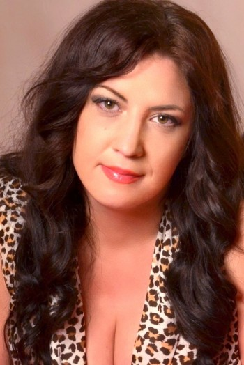 Ukrainian girl Natalia,37 years old with brown eyes and dark brown hair.