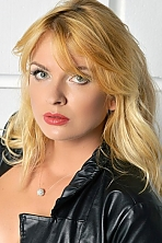 Ukrainian girl Tamara,31 years old with blue eyes and blonde hair.