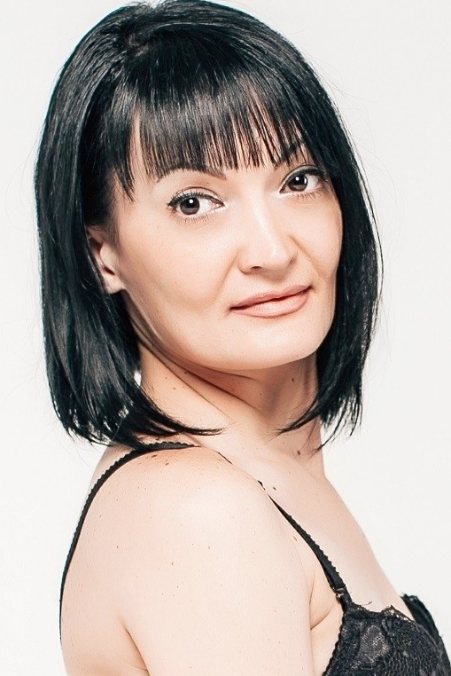 Ukrainian girl Natalia,38 years old with hazel eyes and black hair.