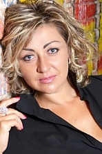 Ukrainian girl Natalia,38 years old with grey eyes and light brown hair.