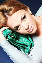 Ukrainian girl Viktoriya,42 years old with green eyes and dark brown hair.