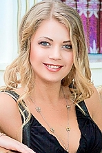 Ukrainian girl Anna,31 years old with blue eyes and blonde hair.