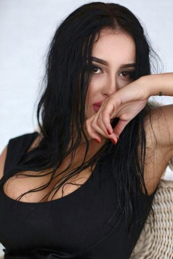 Ukrainian girl Julia,23 years old with brown eyes and dark brown hair.