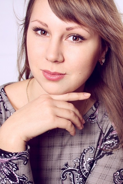 Ukrainian girl Anna,22 years old with brown eyes and blonde hair.