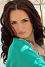 Ukrainian girl Oksana,41 years old with brown eyes and dark brown hair.