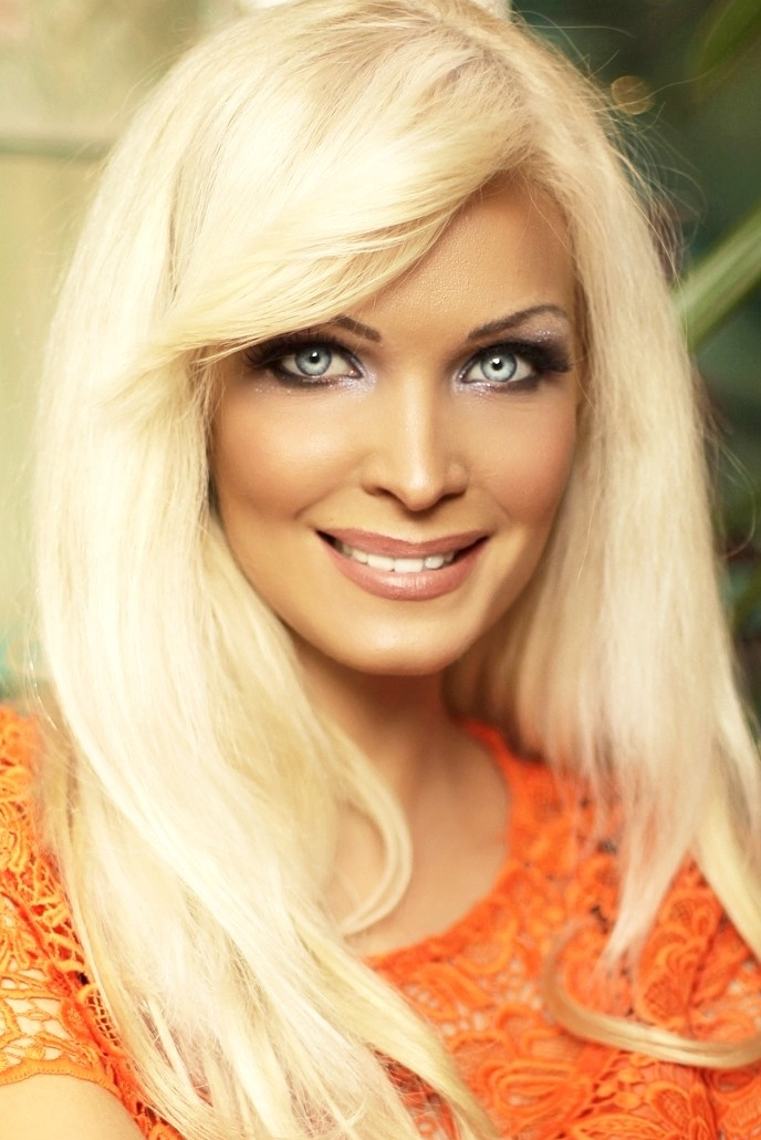 Ukrainian girl Angelina,34 years old with blue eyes and blonde hair.