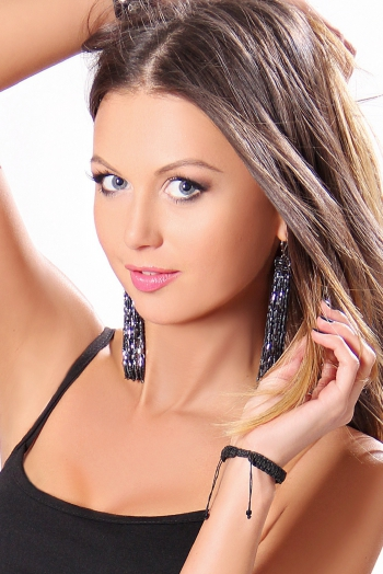 Ukrainian girl Olesya,29 years old with blue eyes and light brown hair.