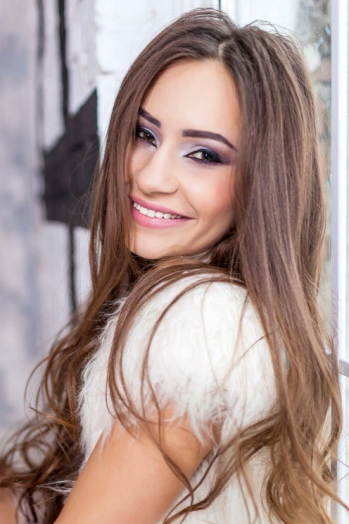 Ukrainian girl Bogdana,22 years old with brown eyes and light brown hair.
