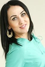 Ukrainian girl Larisa,29 years old with green eyes and dark brown hair.