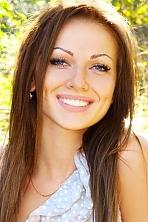 Ukrainian girl Svetlana,24 years old with blue eyes and dark brown hair.