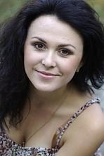 Ukrainian girl Irina,25 years old with brown eyes and black hair.