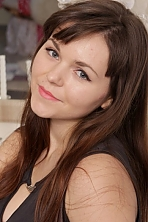 Ukrainian girl Polina,23 years old with green eyes and dark brown hair.