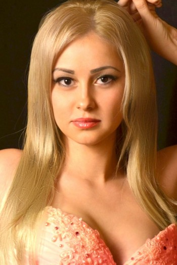Ukrainian girl Mariana,30 years old with brown eyes and blonde hair.
