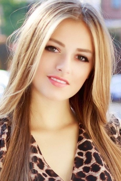 Ukrainian girl Christina,21 years old with green eyes and blonde hair.