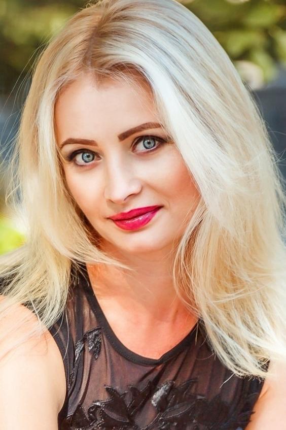 Ukrainian girl Olga,40 years old with blue eyes and blonde hair.