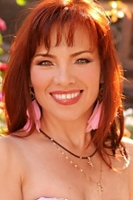 Ukrainian girl Tatiana,52 years old with green eyes and dark brown hair.