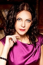 Ukrainian girl Yuliya,42 years old with blue eyes and dark brown hair.