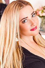 Ukrainian girl Julia,29 years old with green eyes and blonde hair.
