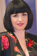 Ukrainian girl Lesya,32 years old with green eyes and dark brown hair.