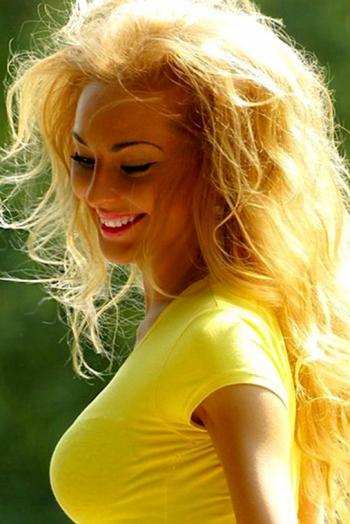 Ukrainian girl Yuliya,28 years old with green eyes and blonde hair.