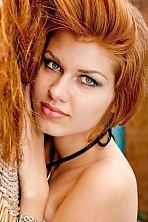 Ukrainian girl Inga,22 years old with green eyes and red hair.