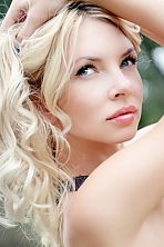 Ukrainian girl Yana,31 years old with grey eyes and black hair.