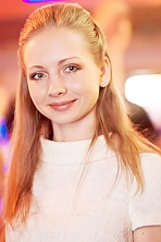 Russian girl Natalia,24 years old with blue eyes and light brown hair.