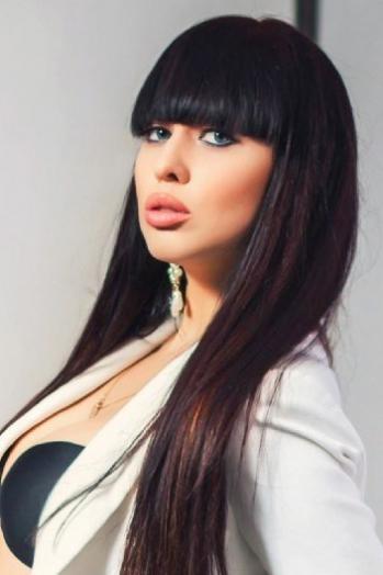 Ukrainian girl Karina,25 years old with blue eyes and black hair.