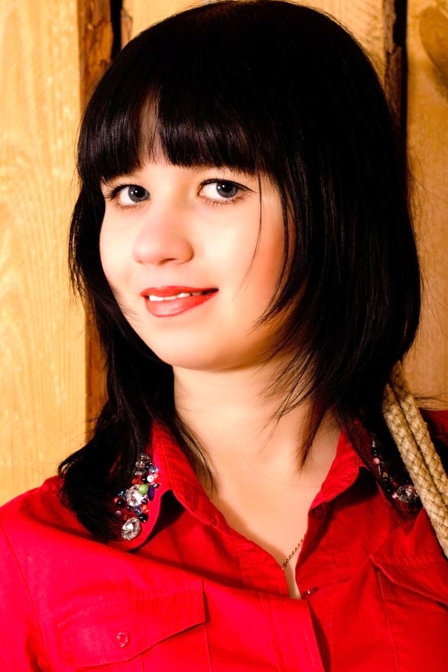 Ukrainian girl Tatiana,20 years old with blue eyes and black hair.