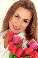 Ukrainian girl Alisa,37 years old with brown eyes and dark brown hair.