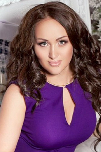 Ukrainian girl Tatyana ,27 years old with blue eyes and black hair.