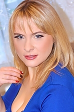 Ukrainian girl Larisa,34 years old with grey eyes and blonde hair.