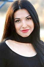 Ukrainian girl Elena,23 years old with green eyes and black hair.