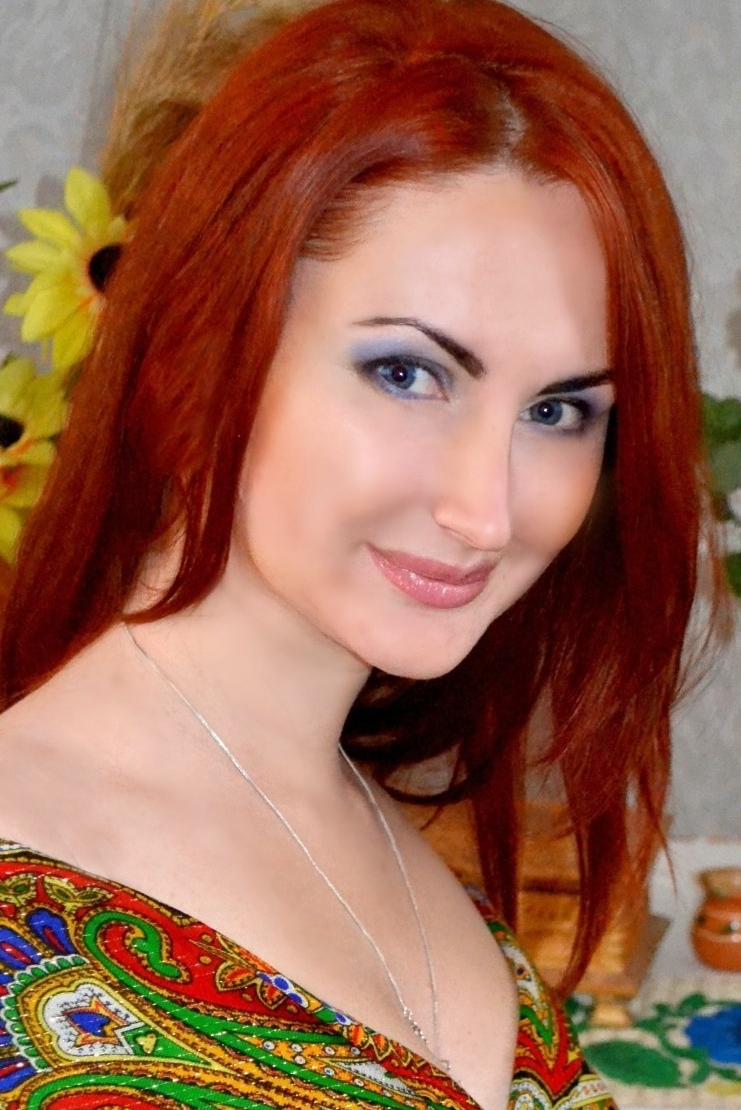 Ukrainian girl Anna,33 years old with blue eyes and red hair.
