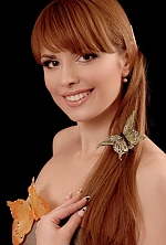 Ukrainian girl Ludmila,35 years old with hazel eyes and light brown hair.