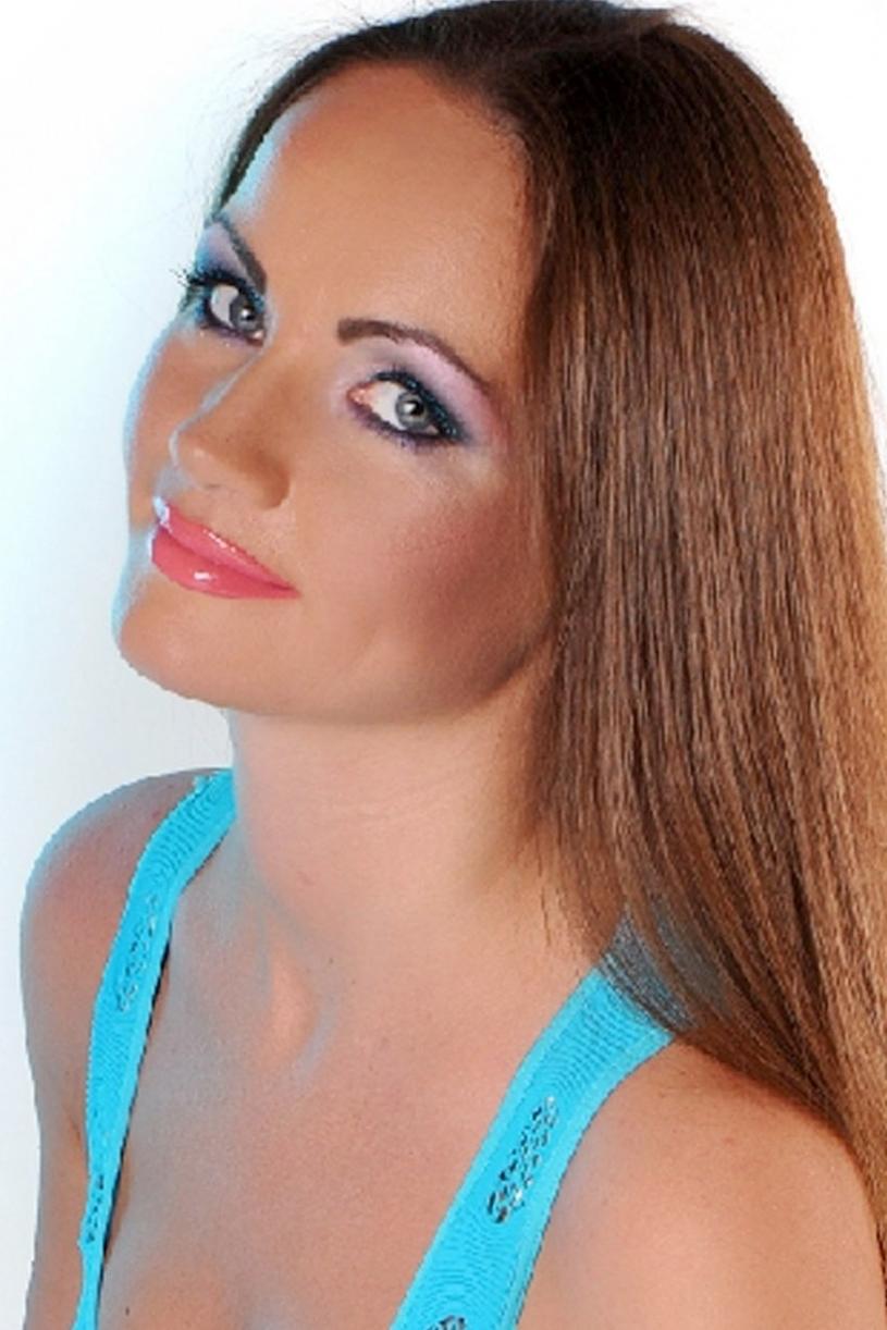 Ukrainian girl Lidia,37 years old with grey eyes and dark brown hair.